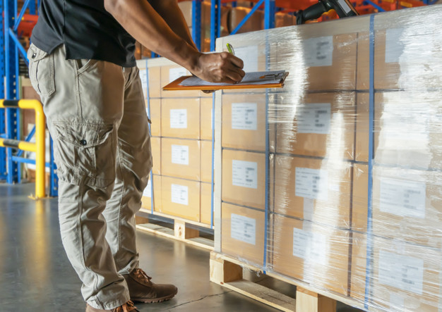 warehouse-worker-holding-clipboard-is-inventory-cargo-products-warehouse_36860-581