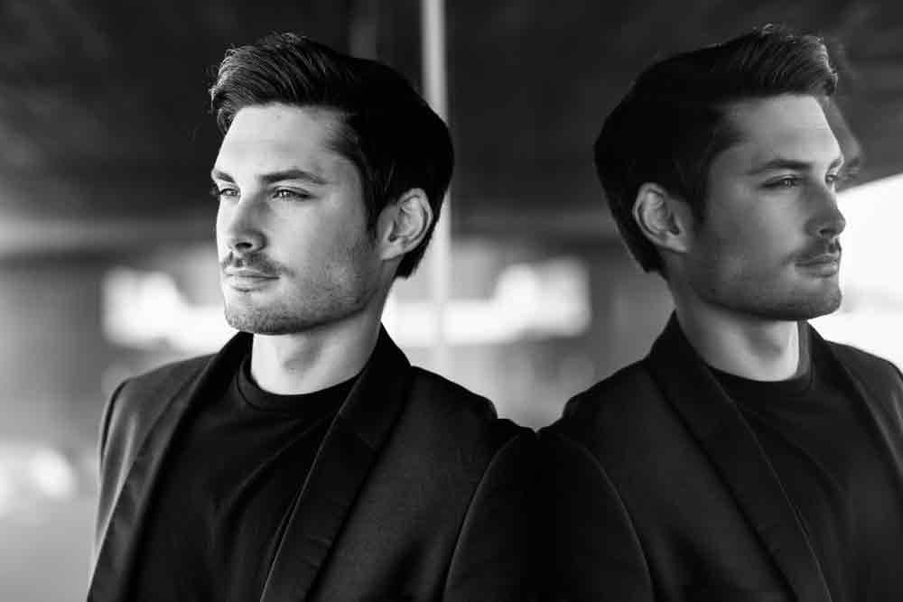 handsome-man-model-of-fashion-wearing-modern-suit-6NMYKTS