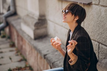 woman-applying-fragrance-her-neck_1303-24737