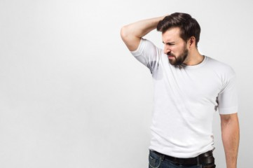 handsome-guy-is-sniffing-his-armpit-there-is-big-sweat-spot-guy-doesn-t-like-it-all-shrinking-he-doesn-t-like-smell-it-isolated-white-wall_152404-2406