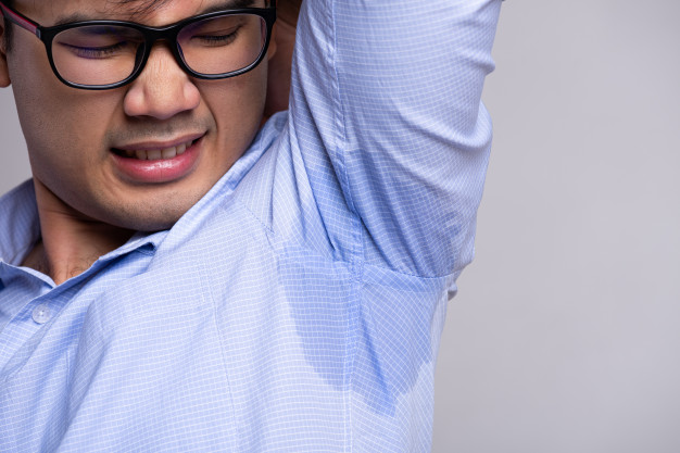 man-with-hyperhidrosis-sweating-his-clothes-healthcare-concept_53476-4851