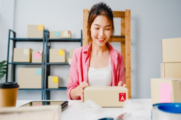 young-asia-entrepreneur-businesswoman-packing-product-cardboard-box-deliver-customer-working-home-office-small-business-owner-start-up-online-market-delivery-lifestyle-freelance-concept_7861-26