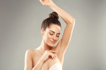 young-woman-holding-her-arms-up-showing-clean-underarms_231834-566