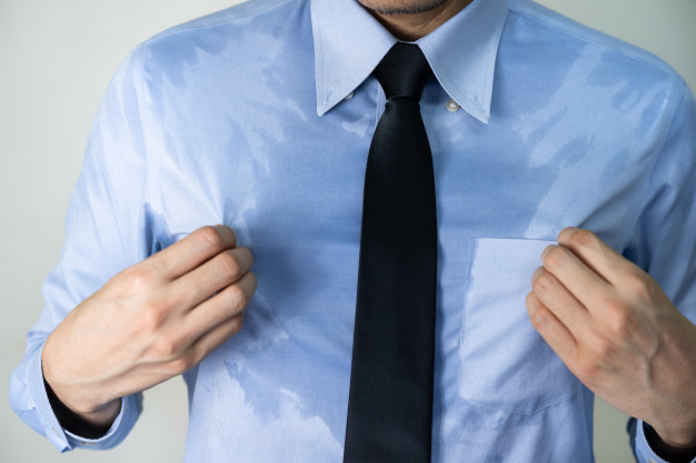 sweating-business-man-due-hot-climate-after-work-outdoor_103324-494