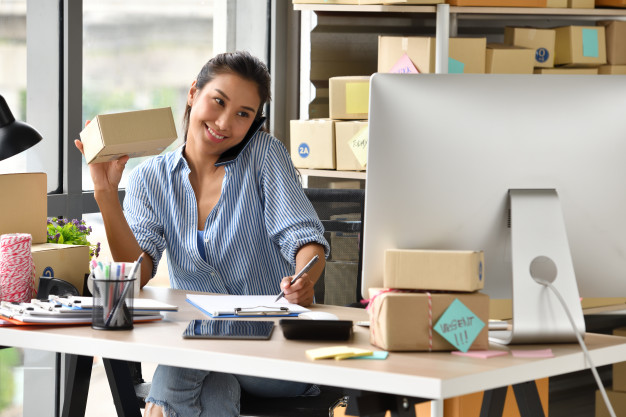 young-asian-woman-entrepreneur-business-owner-working-with-computer-home_126277-97